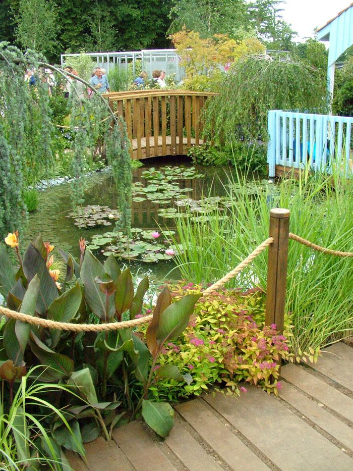 Hampton court flower show for Garden decking with pond